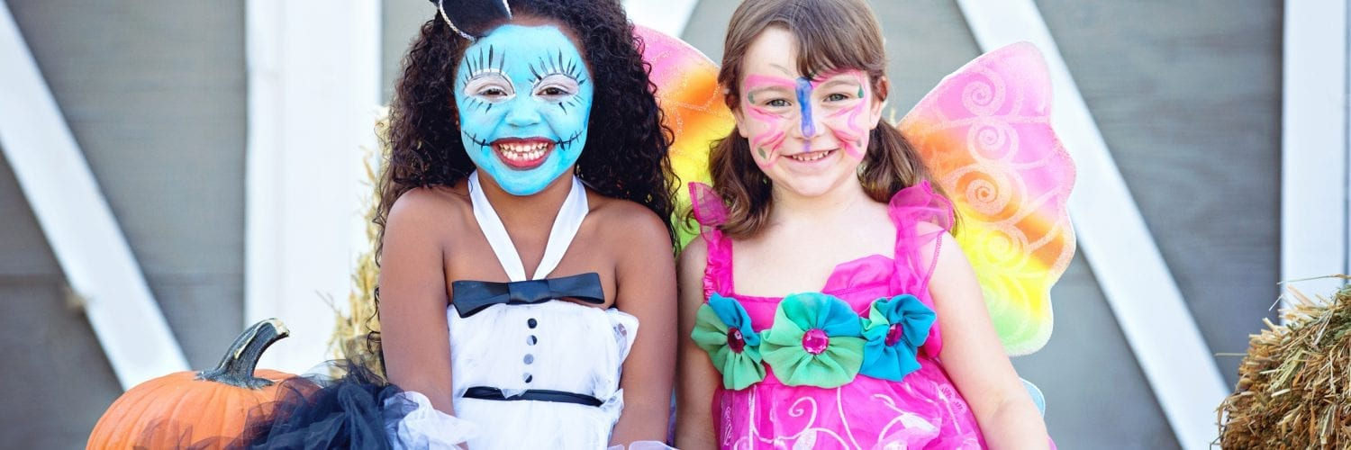 two girls in costume at A halloween party